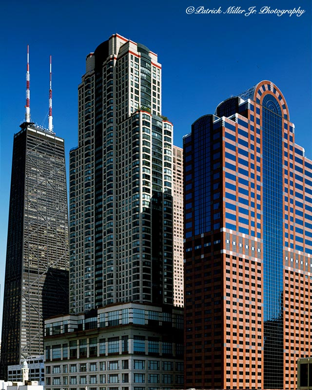 Architecture, skyscrapers in downtown Chicago Illinois with blue sky and vivid colors