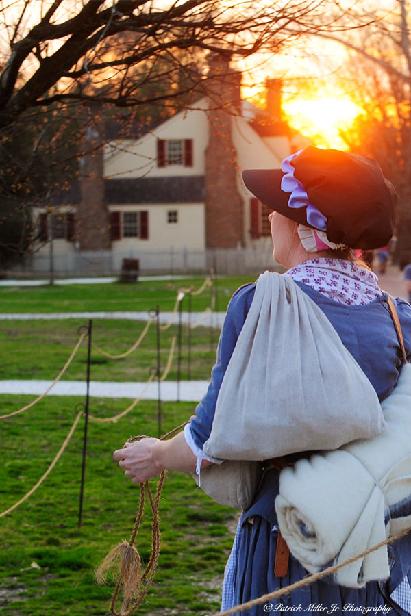 Women retiring for the day in Colonial Williamsburg at sunset