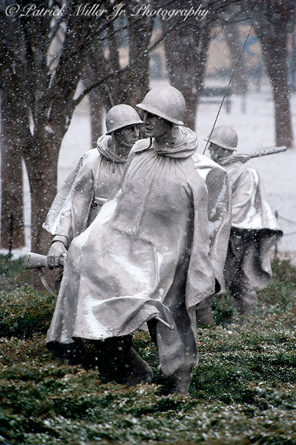 Korean War Veterans Memorial statues in the winter with snow. Located southeast of the Lincoln Memorial Washington, DC