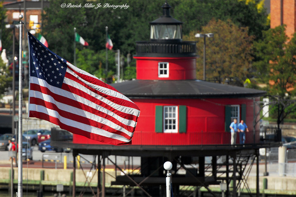 Seven Foot Knoll Lighthouse with a large American Flag Baltimore, MD