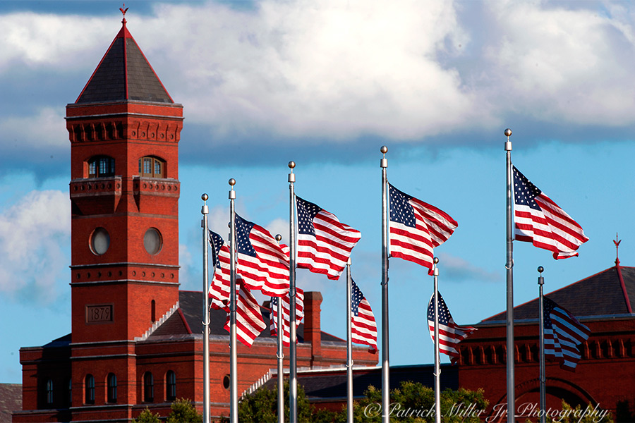 US Flags blowing In the wind at the Smithsonian Institution's Arts and Industries Building or The Castle in Washington, DC