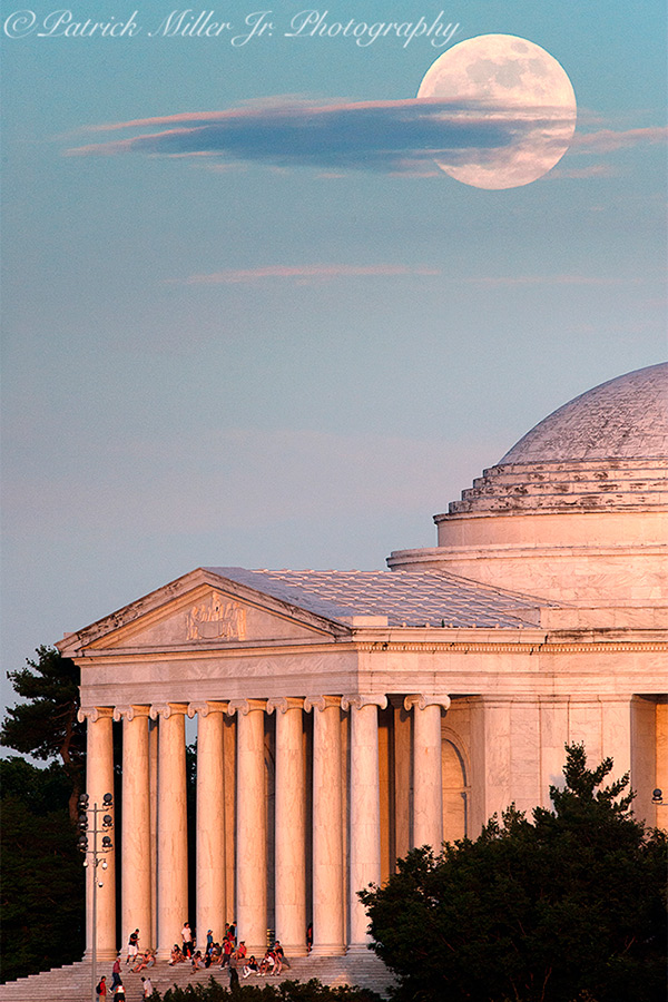 Thomas Jefferson Memorial with a bright full moon above at dusk, Washington DC