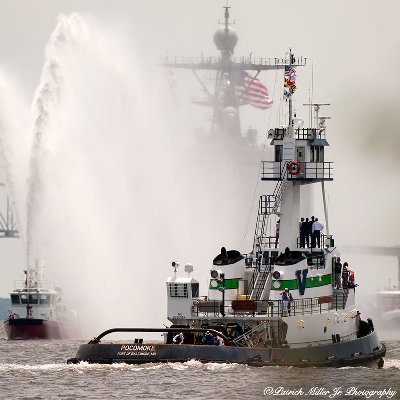 Tug boat and navy vessel in the mist Baltimore Harbor, MD