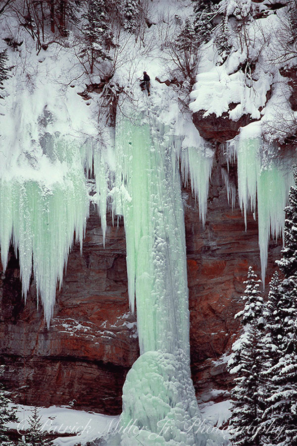 Frozen waterfalls with ice climber Vale, CO