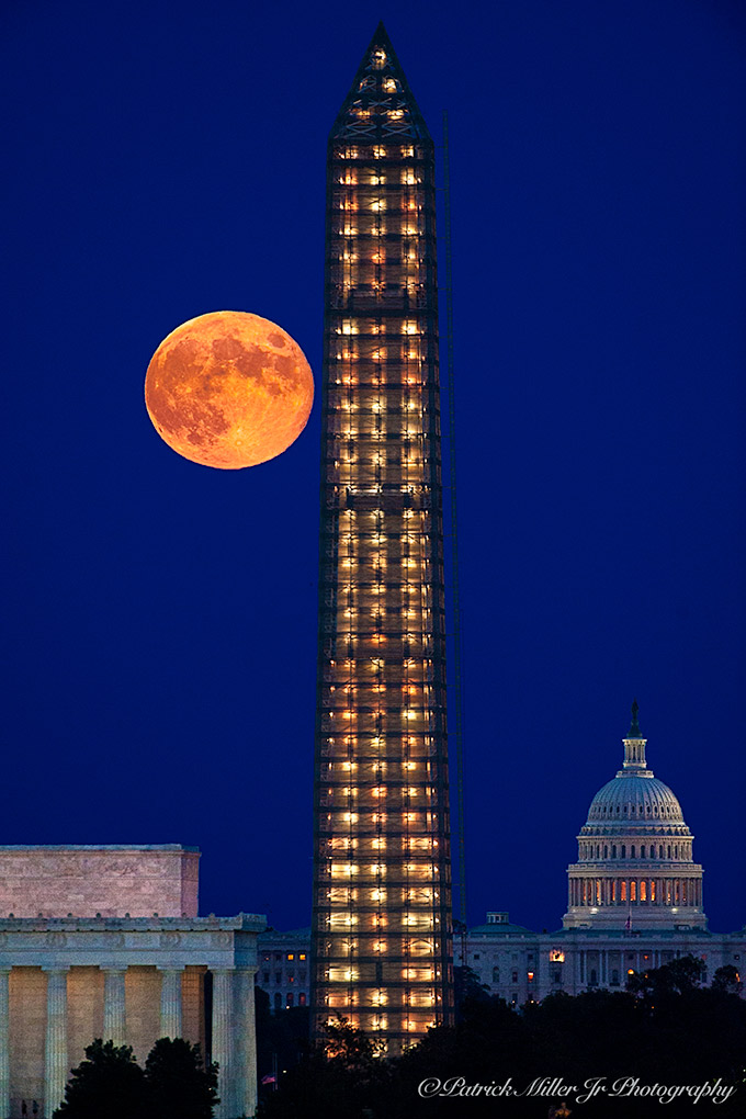 Full Super Moon rising over the Lincoln Memorial, Washington Monument and US Capitol