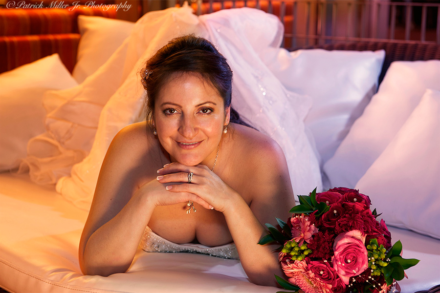 Portrait of a bride on her wedding day on a couch VA