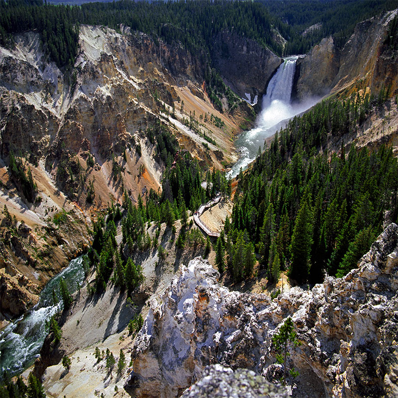 Yellowstone Gorge and Waterfalls in the morning with a winding trail to the bottom MT, WY