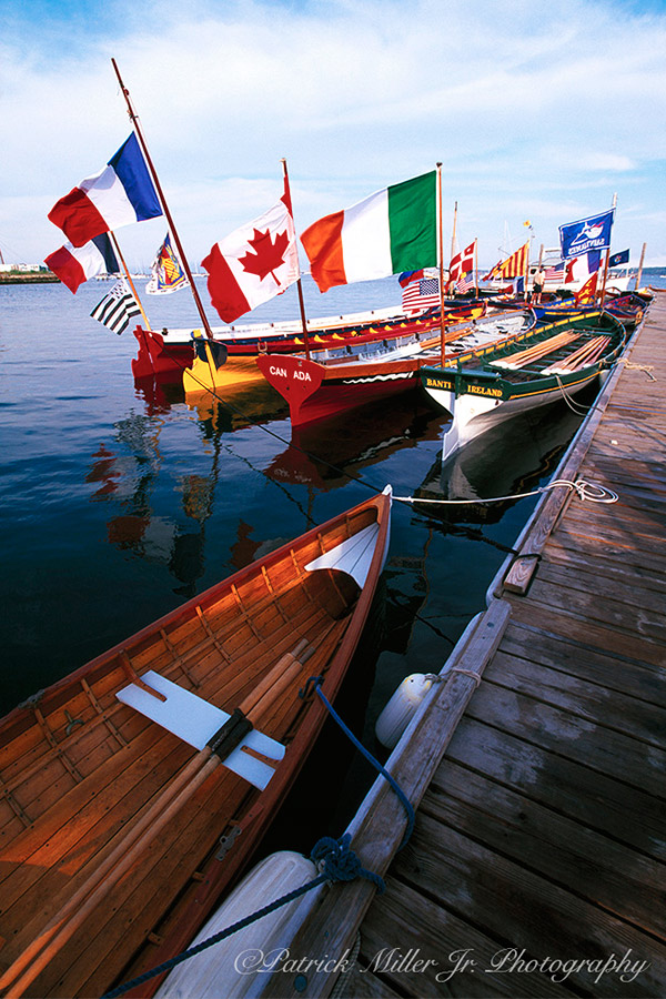 Wooden boats with various International Flags Maine