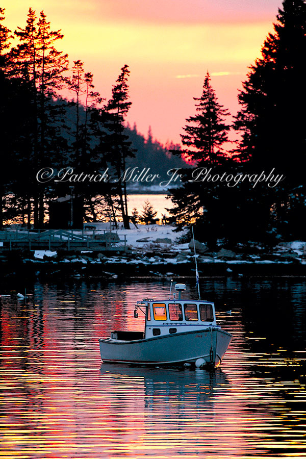 The Amy J. Lobster Boat at sunset in Old Harbor Maine