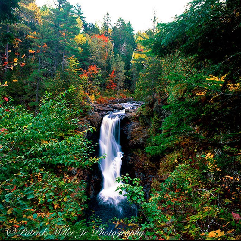 Moxie Waterfalls in the fall surrounded by foliage at Baxter State Park in Maine