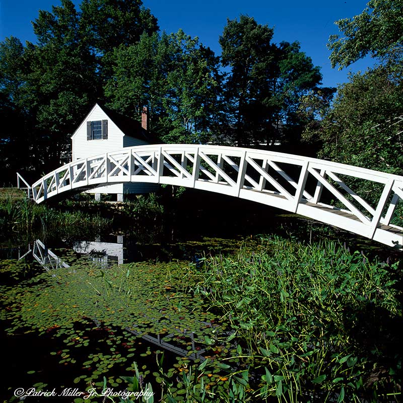 Small house with a wooden walking bridge and reflections located in Somesville Acadia National Park Maine. A Year for Bridges, 2018
