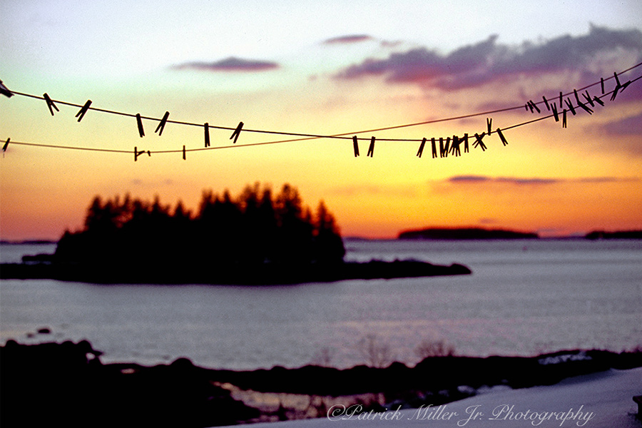 Winter clothes line at sunrise in Maine