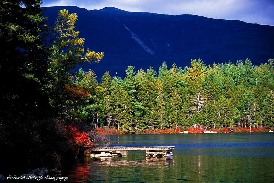 One of Maine's many swimming ponds with a swimming dock in autumn.
