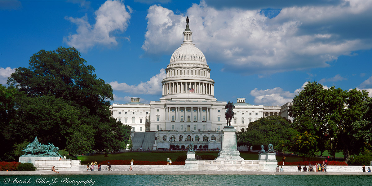 United States Capitol Hill on a summer day with clouds and a blue sky Washington DC