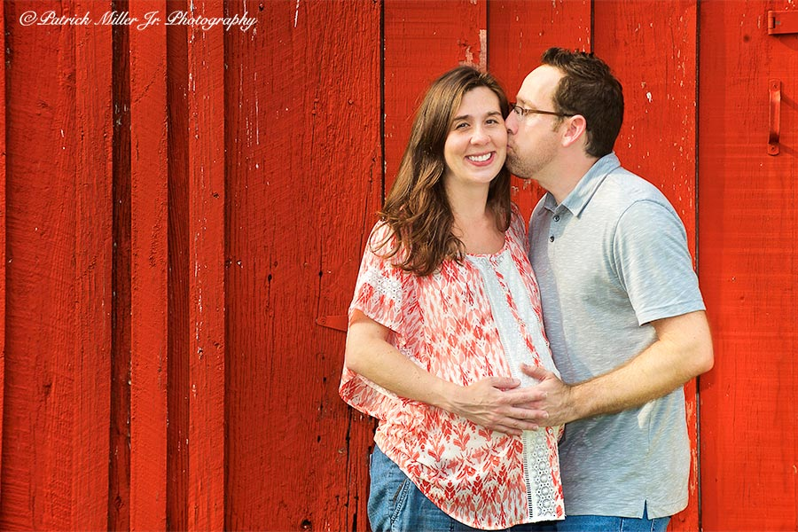 Couple kissing at a farm in Maryland